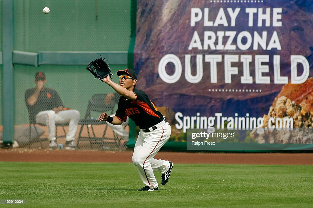Nori Aoki of the San Francisco Giants catches a fly ball for an out against the Milwaukee Brewers during the fourth inning of a Cactus League game at...