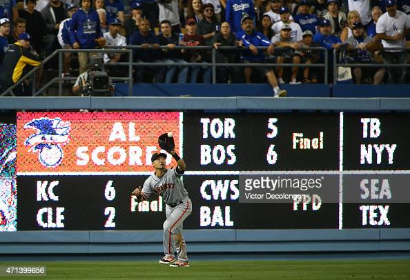 Nori Aoki of the San Francisco Giants catches a fly ball in left field for the third out in the sixth inning during the MLB game against the Los...