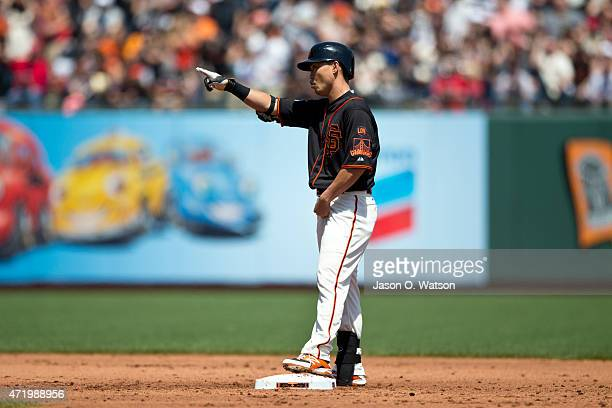 Nori Aoki of the San Francisco Giants celebrates after hitting a two run single against the Los Angeles Angels of Anaheim during the second inning at...
