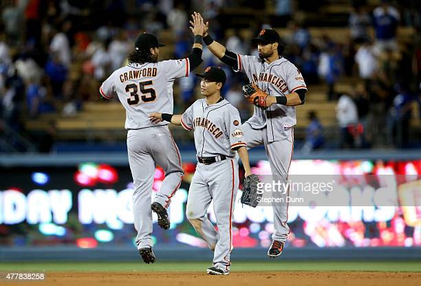 Nori Aoki of the San Francisco Giants celebrates with Brandon Crawford and Angel Pagan after the game with the Los Angeles Dodgers at Dodger Stadium...