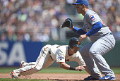 Nori Aoki of the San Francisco Giants dives back into first base safe as the throw comes over to Anthony Rizzo of the Chicago Cubs in the bottom of...
