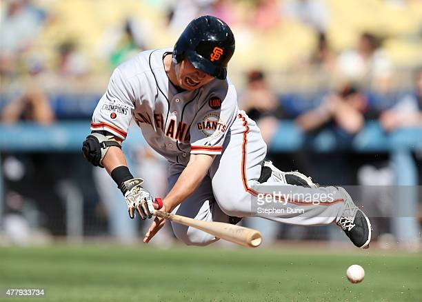 Nori Aoki of the San Francisco Giants goes down after being hit by a pitch in the anke in the first inning against the Los Angeles Dodgers at Dodger...