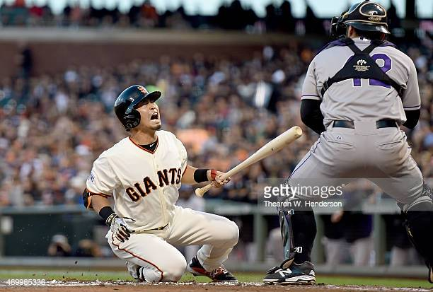 Nori Aoki of the San Francisco Giants goes down in pain after getting hit in the back with a pitch by Tyler Matzek of the Colorado Rockies in the...