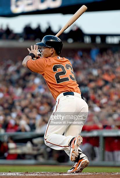 Nori Aoki of the San Francisco Giants hits a double against the Los Angeles Angels of Anaheim in the bottom of the first inning at ATT Park on May 1...