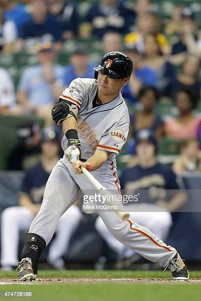 Nori Aoki of the San Francisco Giants hits a single in the first inning against the Milwaukee Brewers at Miller Park on May 25 2015 in Milwaukee...
