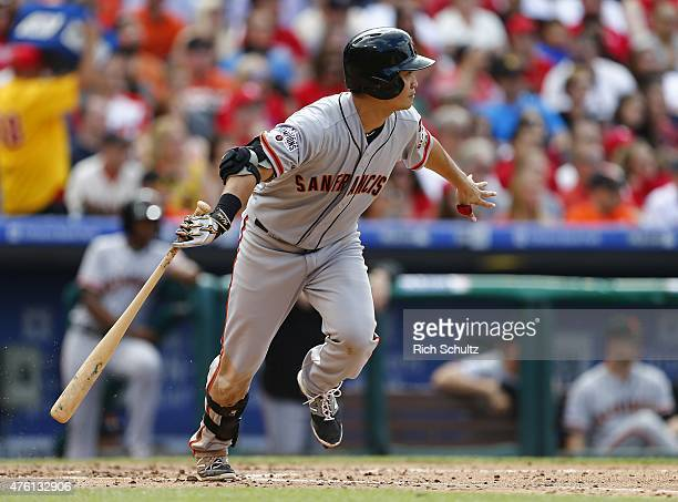 Nori Aoki of the San Francisco Giants hits an RBI single against the Philadelphia Phillies during the third inning of a MLB game at Citizens Bank...