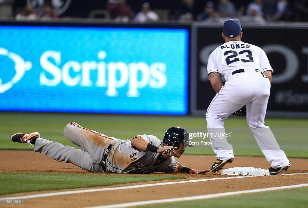 Nori Aoki of the San Francisco Giants is forced out at first base by Yonder Alonso of the San Diego Padres during the first inning of a baseball game...