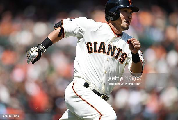 Nori Aoki of the San Francisco Giants races around the bases hitting a double against the Arizona Diamondbacks in the bottom of the first inning at...