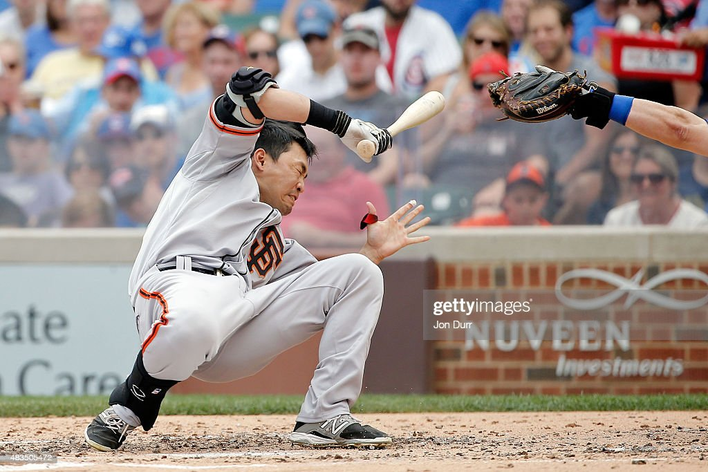 Nori Aoki #23 of the San Francisco Giants reacts after being hit in the head by a pitch thrown by Jake Arrieta #49 of the Chicago Cubs (not pictured) at Wrigley Field on August 9, 2015 in Chicago, Illinois.