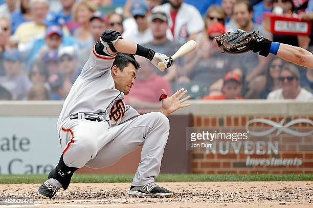 Nori Aoki of the San Francisco Giants reacts after being hit in the head by a pitch thrown by Jake Arrieta of the Chicago Cubs at Wrigley Field on...