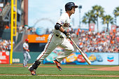 Nori Aoki of the San Francisco Giants runs to first base after hitting a fly ball for an out against the St Louis Cardinals during the first inning...