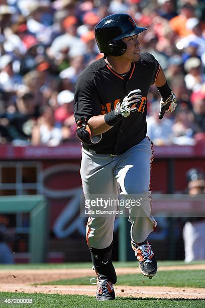 Nori Aoki of the San Francisco Giants runs to first base after hitting a single in the first inning against the Los Angeles Angels of Anaheim during...