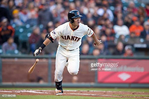 Nori Aoki of the San Francisco Giants runs to first base after hitting a ground ball for an out during the first inning against the San Diego Padres...