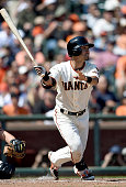 Nori Aoki of the San Francisco Giants swings and watches the flight of his ball as he hits a triple againt the Arizona Diamondbacks in the bottom of...