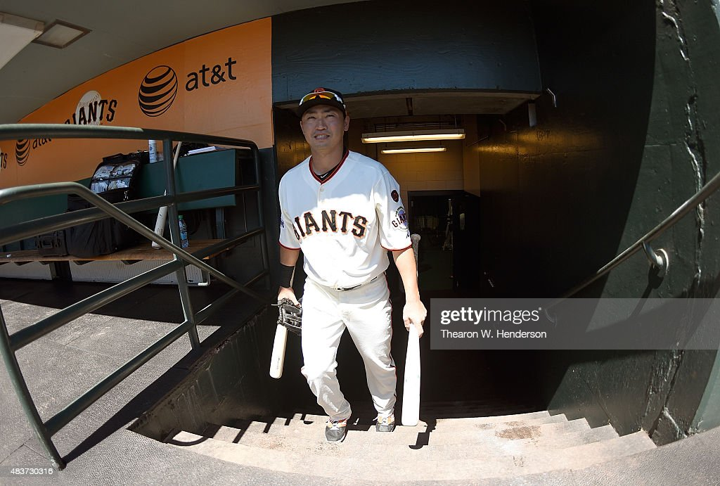 Nori Aoki #23 of the San Francisco Giants walks up the stairs into the dugout prior to the start of the game against the Houston Astros at AT&T Park on August 12, 2015 in San Francisco, California.