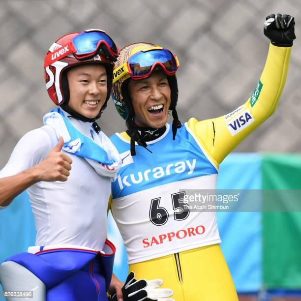 Noriaki Kasai celerbates after winning he men's event with second place Ryoyu Kobayashi during the Miyanomori Sumemr Ski Jumping Championships at...