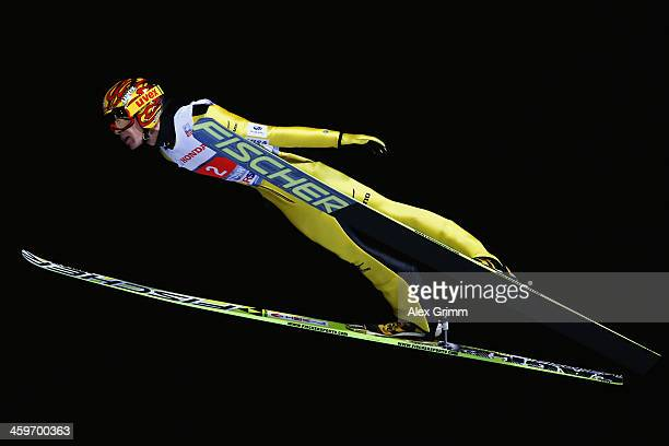 Noriaki Kasai of Japan competes during the first round on day 2 of the Four Hills Tournament Ski Jumping event at SchattenbergSchanze on December 29...