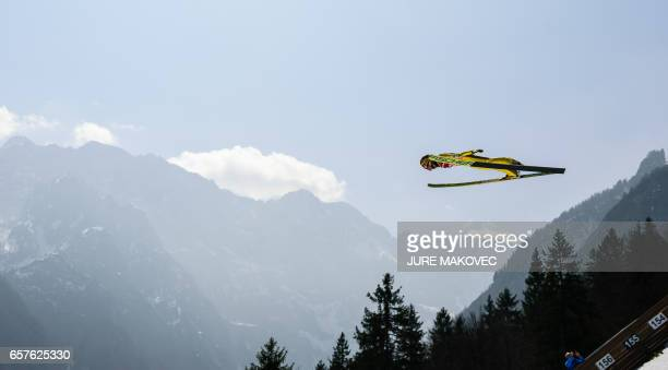 TOPSHOT Noriaki Kasai of Japan competes during the FIS Ski Jumping World Cup Flying Hill Team Event in Planica on March 25 2017 / AFP PHOTO / Jure...
