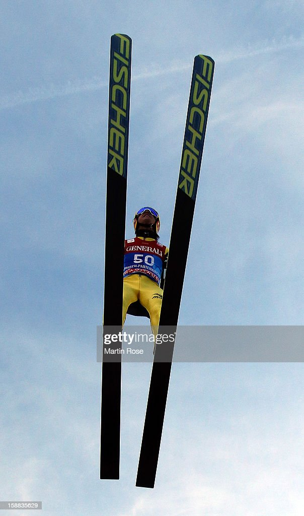 Noriaki Kasai of Japan competes during the trial round for the FIS Ski Jumping World Cup event of the 61st Four Hills ski jumping tournament at Olympiaschanze on December 31, 2012 in Garmisch-Partenkirchen, Germany.