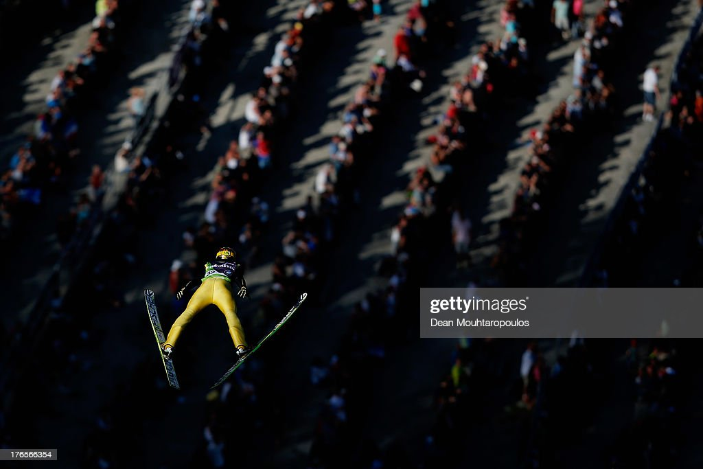 <a gi-track='captionPersonalityLinkClicked' href=/galleries/search?phrase=Noriaki+Kasai&family=editorial&specificpeople=722779 ng-click='$event.stopPropagation()'>Noriaki Kasai</a> of Japan competes in the FIS Ski Jumping Grand Prix Mens Large Hill Individual Training Session on August 15, 2013 in Courchevel, France.