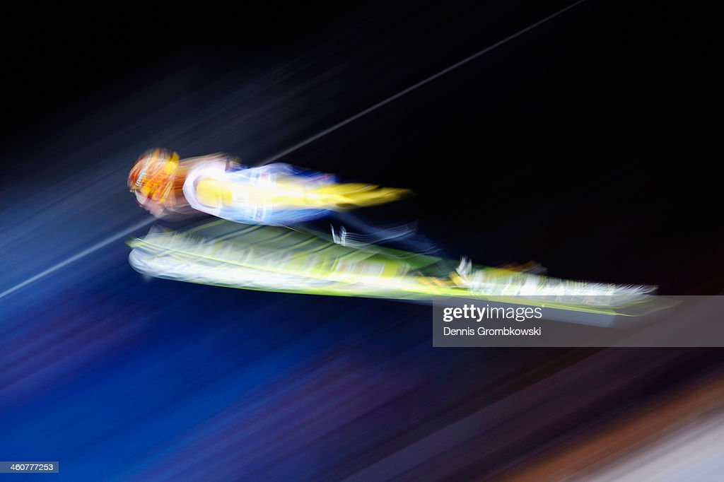 Noriaki Kasai of Japan soars through the air during his first trial jump on day 1 of the 62nd Four Hills Tournament event at PaulAuflerleitnerSchanze...