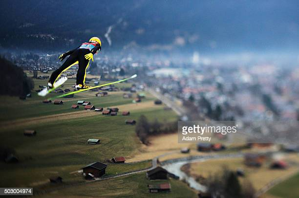Noriaki Kasai of Japan soars through the air during his qualification jump on Day 1 of the 64th Four Hills tounament on December 31 2015 in...
