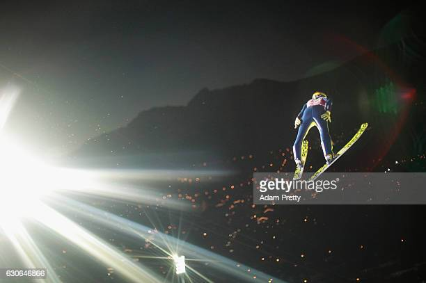 Noriaki Kasai of Japan soars through the air during his qualification jump on Day 1 of the 65th Four Hills Tournament ski jumping event on December...