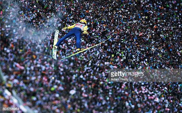 Noriaki Kasai soars through the air and over the grandstand during his final competition jump on day 2 of the Innsbruck 64th Four Hills Tournament on...
