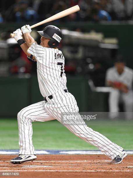 Norichika Aoki of Japan hits a double in the first inning of the World Baseball Classic Pool B Game One between Cuba and Japan at Tokyo Dome on March...