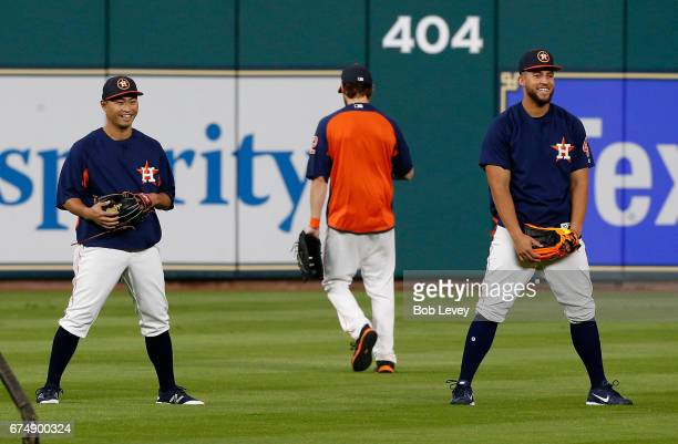 Norichika Aoki of the Houston Astros and George Springer share a laugh during batting practice at Minute Maid Park on April 29 2017 in Houston Texas