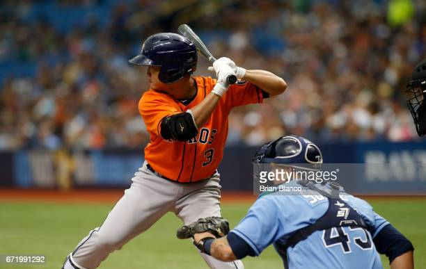 Norichika Aoki of the Houston Astros bats in front of catcher Jesus Sucre of the Tampa Bay Rays during the second inning of a game on April 23 2017...