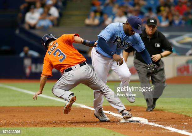 Norichika Aoki of the Houston Astros beats first baseman Rickie Weeks of the Tampa Bay Rays back to first base to avoid getting picked off during the...