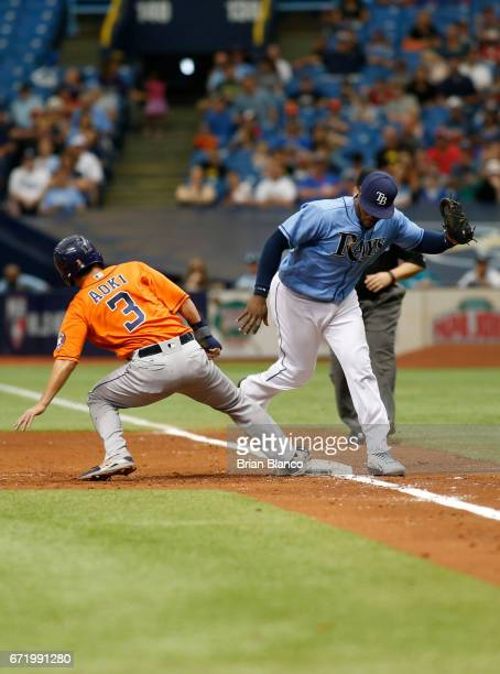 Norichika Aoki of the Houston Astros beats first baseman Rickie Weeks of the Tampa Bay Rays back to first base to avoid the pickoff during the second...