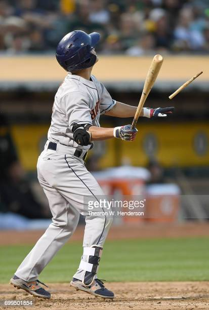 Norichika Aoki of the Houston Astros breaks his bat while popping out to third baseman Ryon Healy of the Oakland Athletics in the top of the fifth...