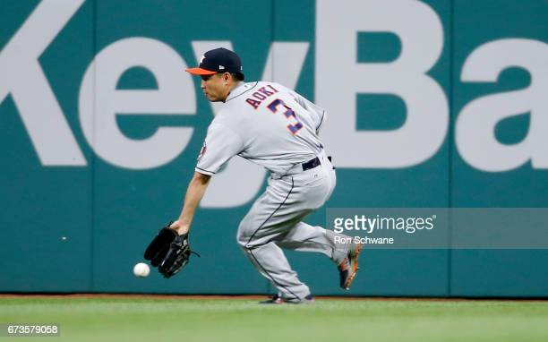 Norichika Aoki of the Houston Astros fields a single off the bat of Edwin Encarnacion of the Cleveland Indians during the seventh inning at...