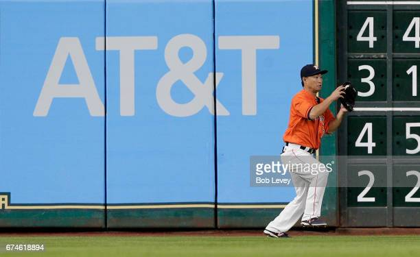 Norichika Aoki of the Houston Astros fields the ball off the wall in the fourth inning against the Oakland Athletics at Minute Maid Park on April 28...