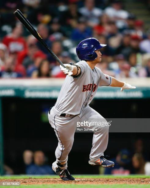 Norichika Aoki of the Houston Astros hits a single off Bryan Shaw of the Cleveland Indians during the eighth inning at Progressive Field on April 26...