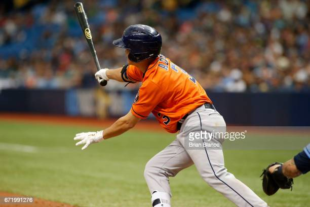 Norichika Aoki of the Houston Astros hits a single to center field during the fourth inning of a game against the Tampa Bay Rays on April 23 2017 at...
