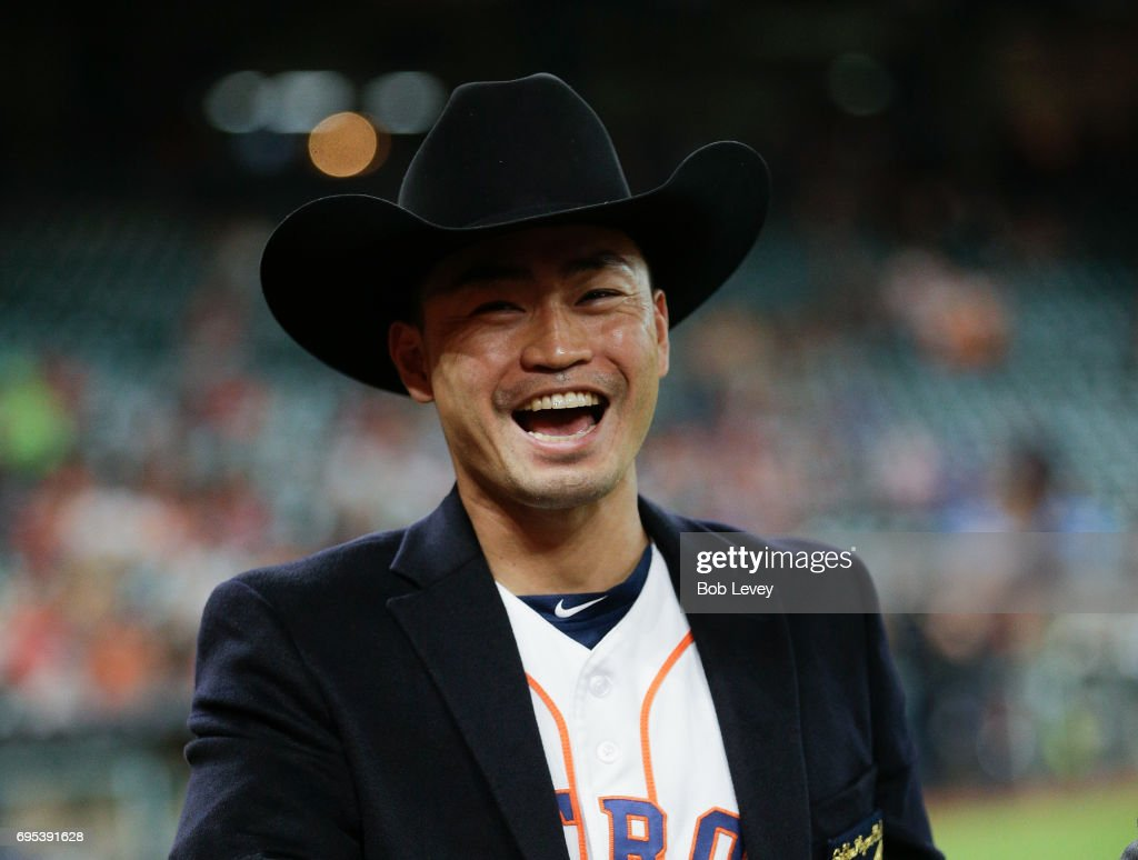 Norichika Aoki #3 of the Houston Astros is given a cowboy hat during pre-game ceremony honoring his induction into the Golden Players Club after reaching his 2,000 career hit at Minute Maid Park on June 12, 2017 in Houston, Texas.