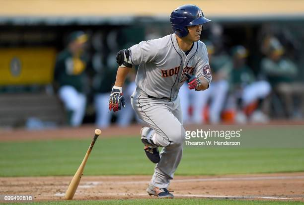 Norichika Aoki of the Houston Astros runs up the first baseline after hitting a single to left field against the Oakland Athletics in the top of the...