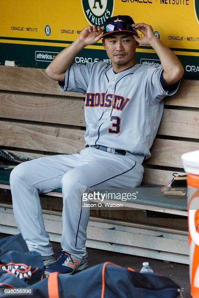 Norichika Aoki of the Houston Astros sits in the dugout before the game against the Oakland Athletics at the Oakland Coliseum on June 19 2017 in...