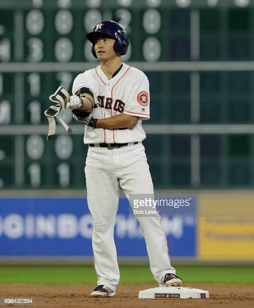 Norichika Aoki of the Houston Astros stands at second base with a double against the Texas Rangers at Minute Maid Park on June 13 2017 in Houston...