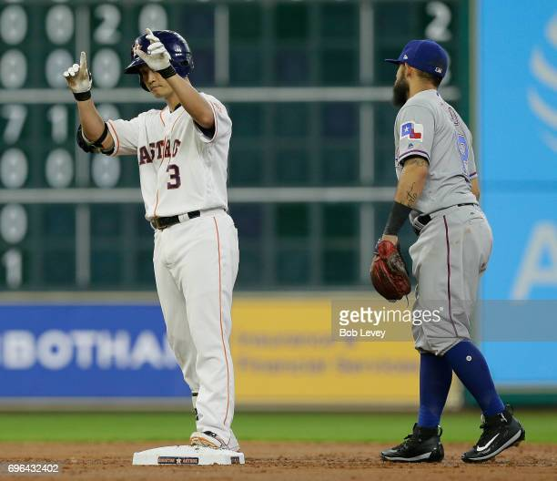 Norichika Aoki of the Houston Astros stands at second base with a double against the Texas Rangers as Rougned Odor of the Texas Rangers looks on at...