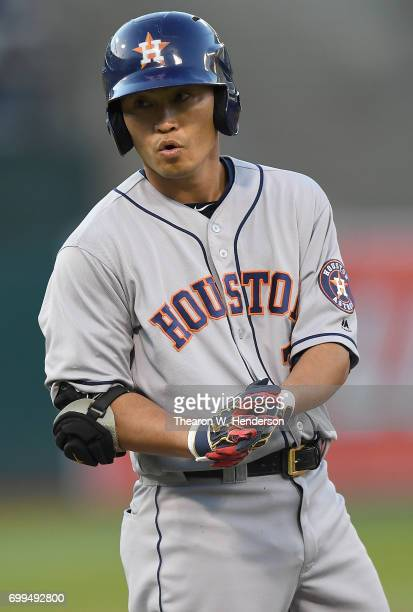 Norichika Aoki of the Houston Astros stands on first base and celebrates after hitting a single against the Oakland Athletics in the top of the third...