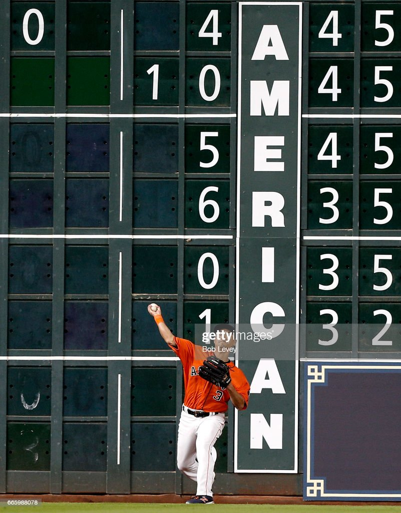 Norichika Aoki #3 of the Houston Astros throws the ball back after a double by Alex Gordon #4 of the Kansas City Royals in the eighth inning at Minute Maid Park on April 7, 2017 in Houston, Texas.
