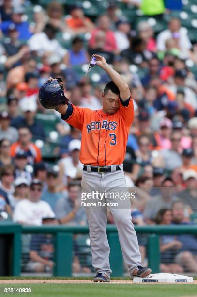 Norichika Aoki of the Houston Astros wipes his forehead during a game against the Detroit Tigers at Comerica Park on July 30 2017 in Detroit Michigan