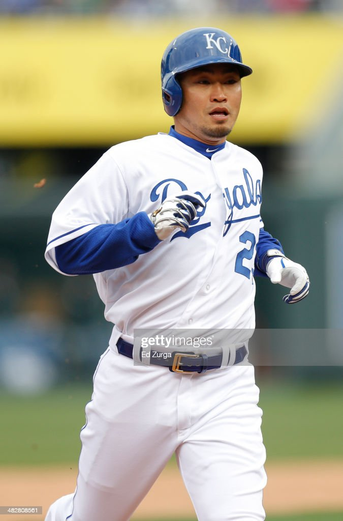 Norichika Aoki #23 of the Kansas City Royals advances to third on a Omar Infante single in the fourth inning during a game against the Chicago White Sox in the Royals home opener at Kauffman Stadium on April 4, 2014 in Kansas City, Missouri.
