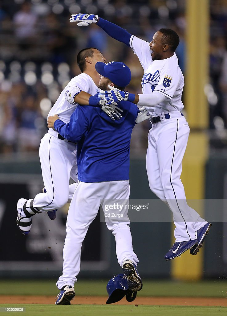 <a gi-track='captionPersonalityLinkClicked' href=/galleries/search?phrase=Norichika+Aoki&family=editorial&specificpeople=850957 ng-click='$event.stopPropagation()'>Norichika Aoki</a> #23 of the Kansas City Royals celebrates with <a gi-track='captionPersonalityLinkClicked' href=/galleries/search?phrase=Danny+Duffy&family=editorial&specificpeople=5971971 ng-click='$event.stopPropagation()'>Danny Duffy</a> #41 and <a gi-track='captionPersonalityLinkClicked' href=/galleries/search?phrase=Jarrod+Dyson&family=editorial&specificpeople=6780110 ng-click='$event.stopPropagation()'>Jarrod Dyson</a> #1 after hitting a game-winning RBI single in the 14th inning against the Cleveland Indians at Kauffman Stadium on July 24, 2014 in Kansas City, Missouri. The Royals won 2-1.
