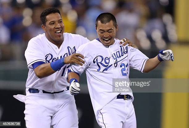 Norichika Aoki of the Kansas City Royals celebrates with Salvador Perez after hitting a gamewinning RBI single in the 14th inning against the...