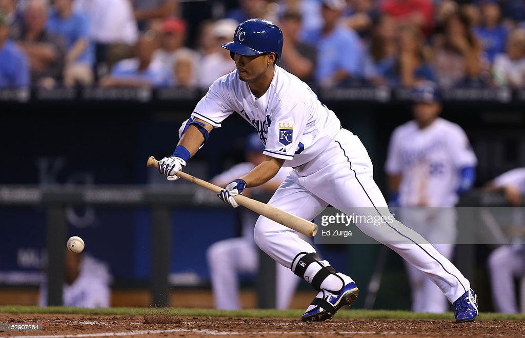 <a gi-track='captionPersonalityLinkClicked' href=/galleries/search?phrase=Norichika+Aoki&family=editorial&specificpeople=850957 ng-click='$event.stopPropagation()'>Norichika Aoki</a> #23 of the Kansas City Royals drops down a bunt in the fourth inning against the Minnesota Twins at Kauffman Stadium on July 29, 2014 in Kansas City, Missouri. Aoki was thrown out on the bunt attempt.